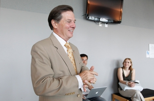 Former House Majority Leader Tom DeLay, R-Sugar Land, speaks with media at the 331st District Court of Travis County during the pretrial hearings on money laundering charges against the former congressman.