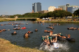 "Floaters splash and stay cool at ""Rockin' the River-Live on the Trinity"", a free event sponsored by the Trinity River Vision."