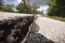Cracks have formed in the asphalt on Bayou Wood Circle near County Road 687 south of Angleton, Texas Tuesday Aug, 2, 2011.
