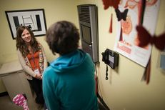 Nicole Griffis, nurse practitioner, consults with a patient at a Planned Parenthood clinic in Austin, Texas.