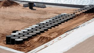 Modular concrete canisters containing nuclear waste are shown at the bottom of a storage pit near Andrews, Texas.