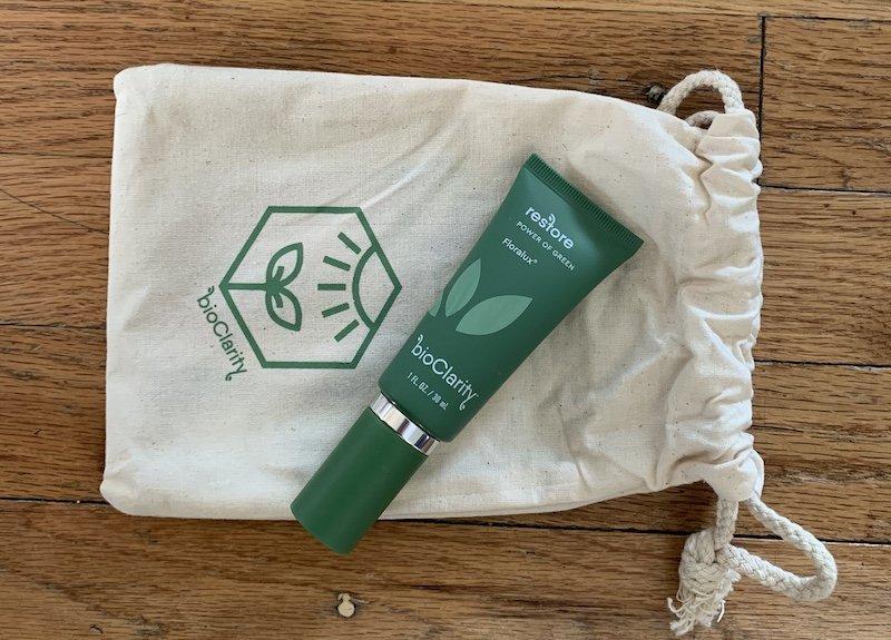 bioClarity Restore Floralux bottle on canvas pouch