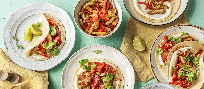 Assortment of HelloFresh dishes featuring tacos and pasta recipes