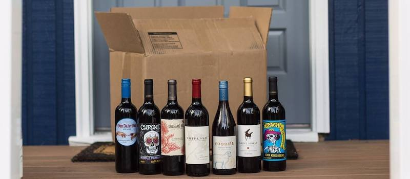 Collection of red wine at doorstep