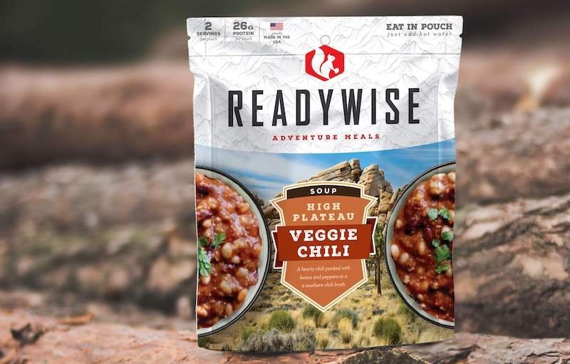 Picture of ReadyWise Veggie Chili emergency food pouch in front of wood background