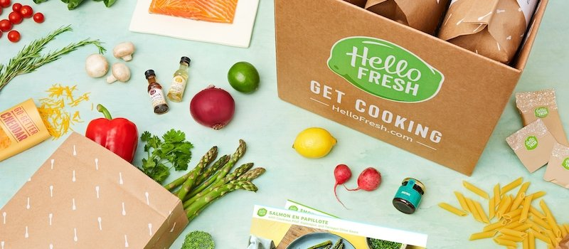 Box of HelloFresh meals next to recipe cards and ingredients