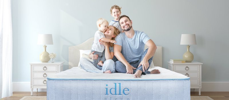 Family sits on Idle Sleep mattress