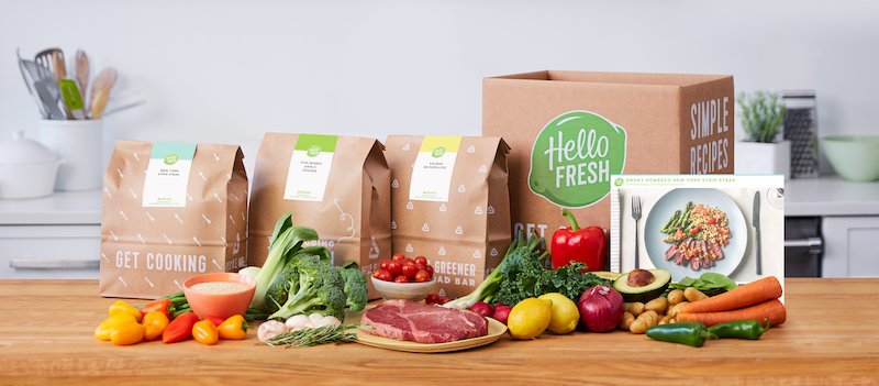 HelloFresh box and bag of recipes with ingredients and recipe card