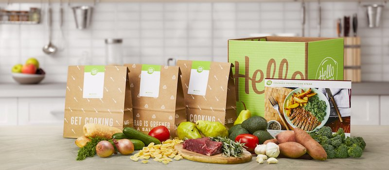 HelloFresh meals lined up on table with box and raw ingredients