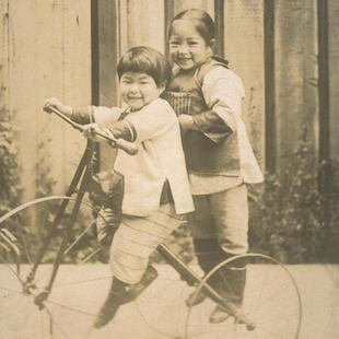 A boy and a girl on a bicycle