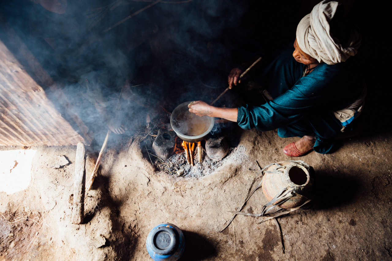 Woman boiling water in Ethiopia
