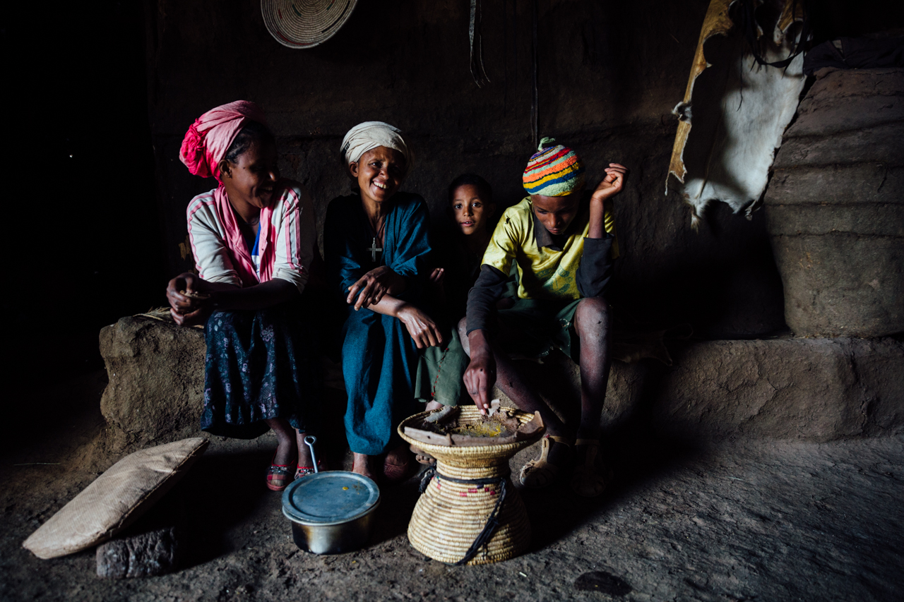 Family sitting in a home in Ethiopia