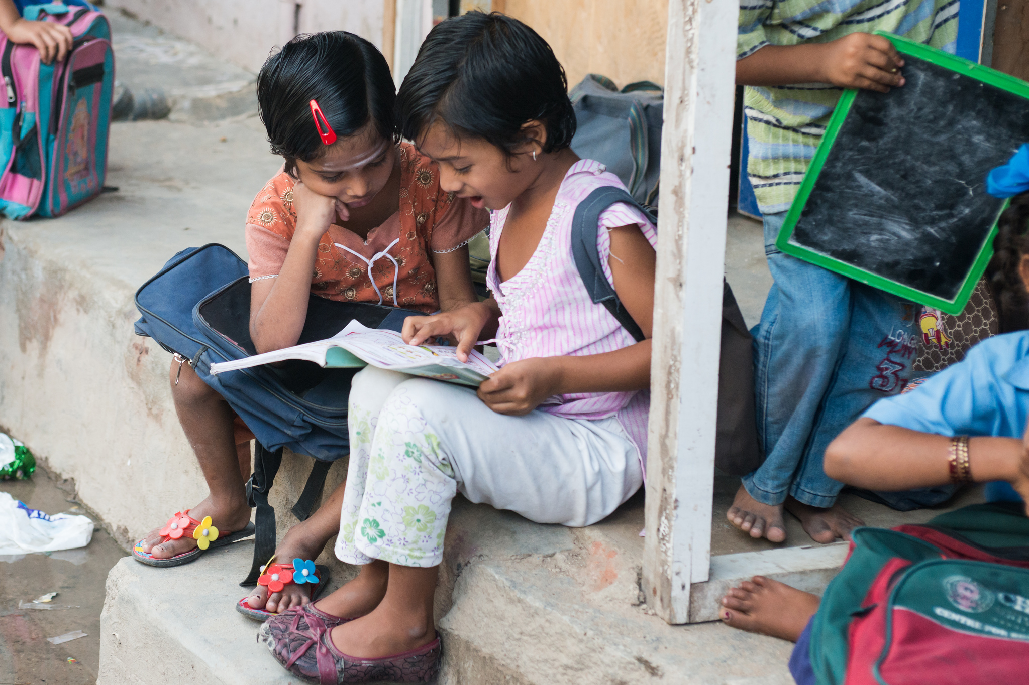 Children reading in India