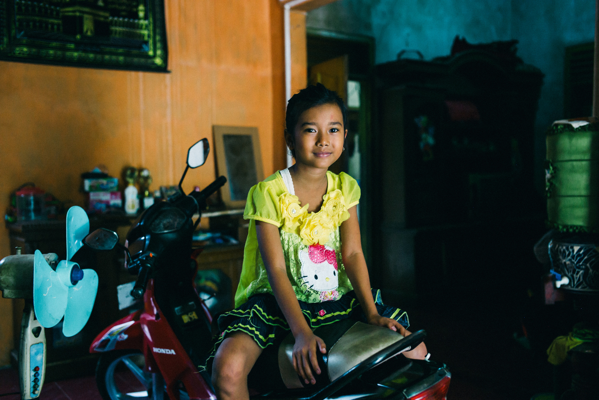 Erni's daughter sitting on a moped