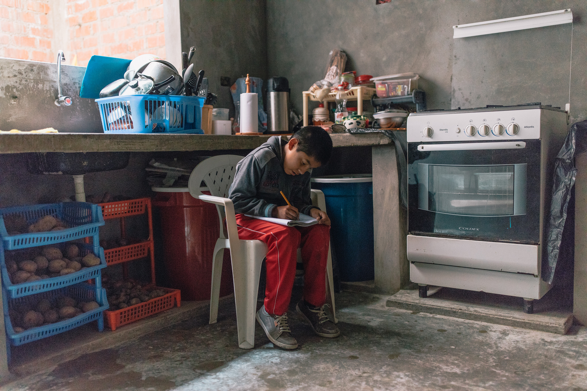 Boy doing homework in Peru