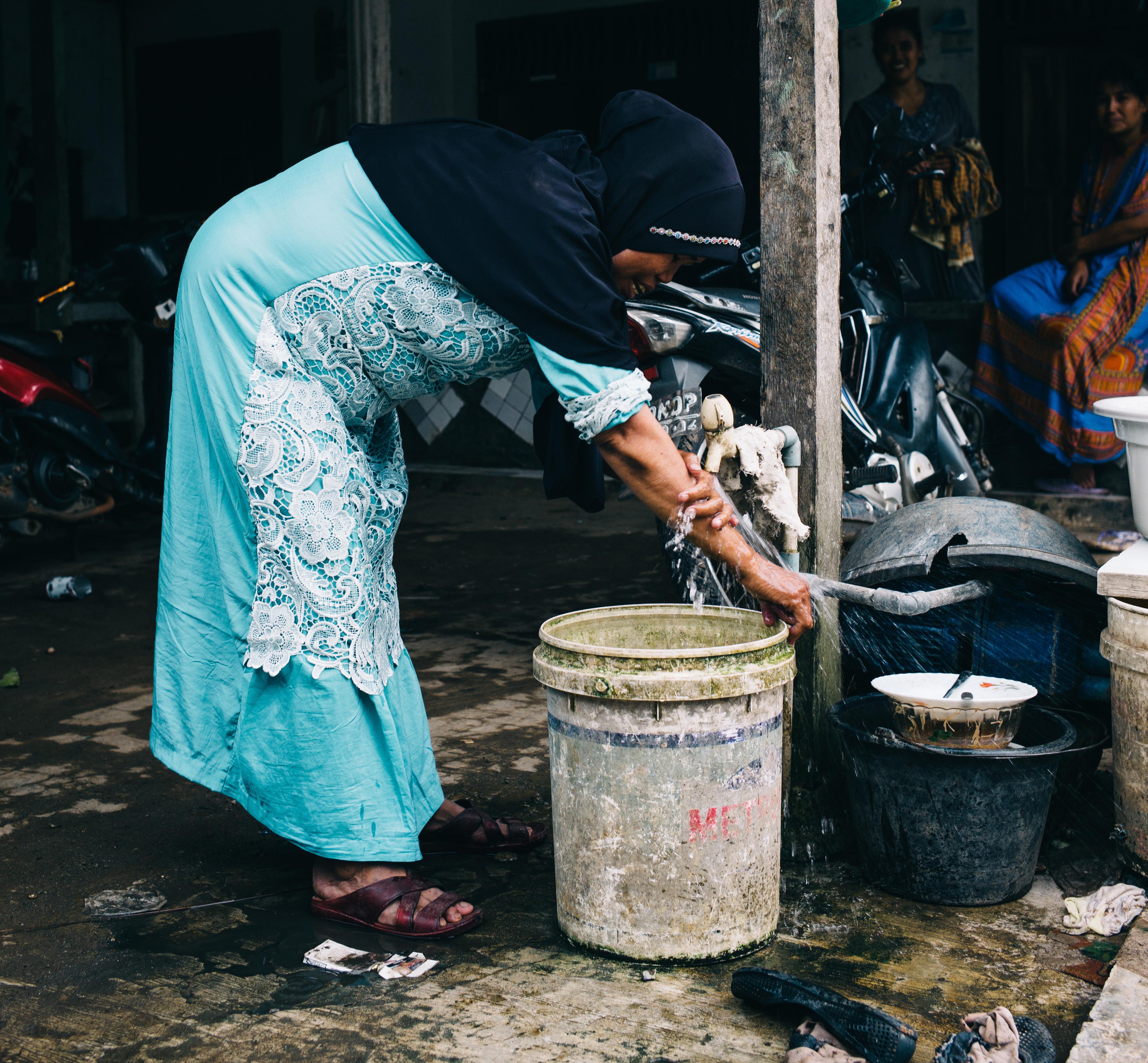 Sarmanah using her safe water tap