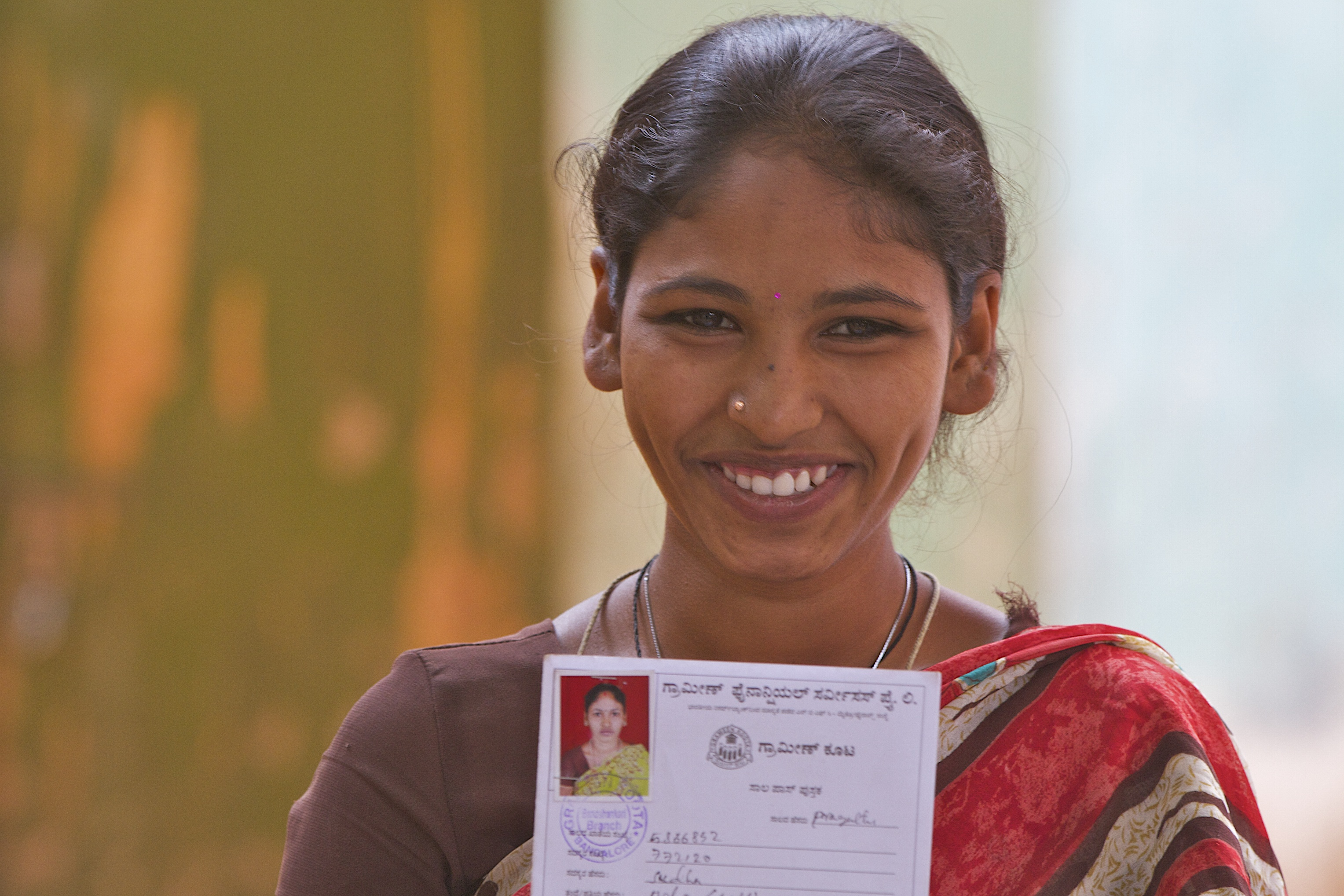 Woman holds her loan card
