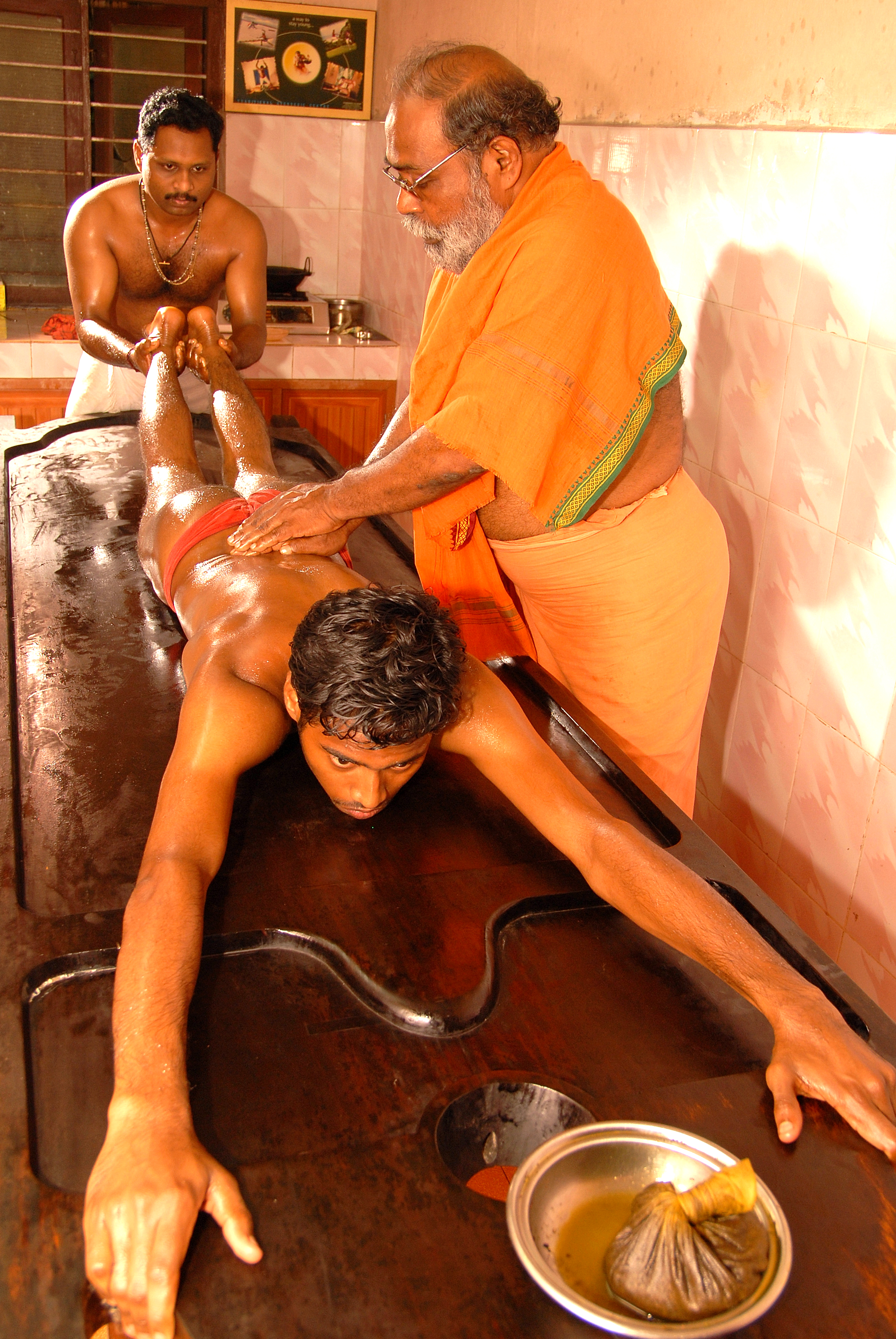Physical Therapy Traction Table Traction Massage in marma therapy given in Sreepathy cvn kalari for ...