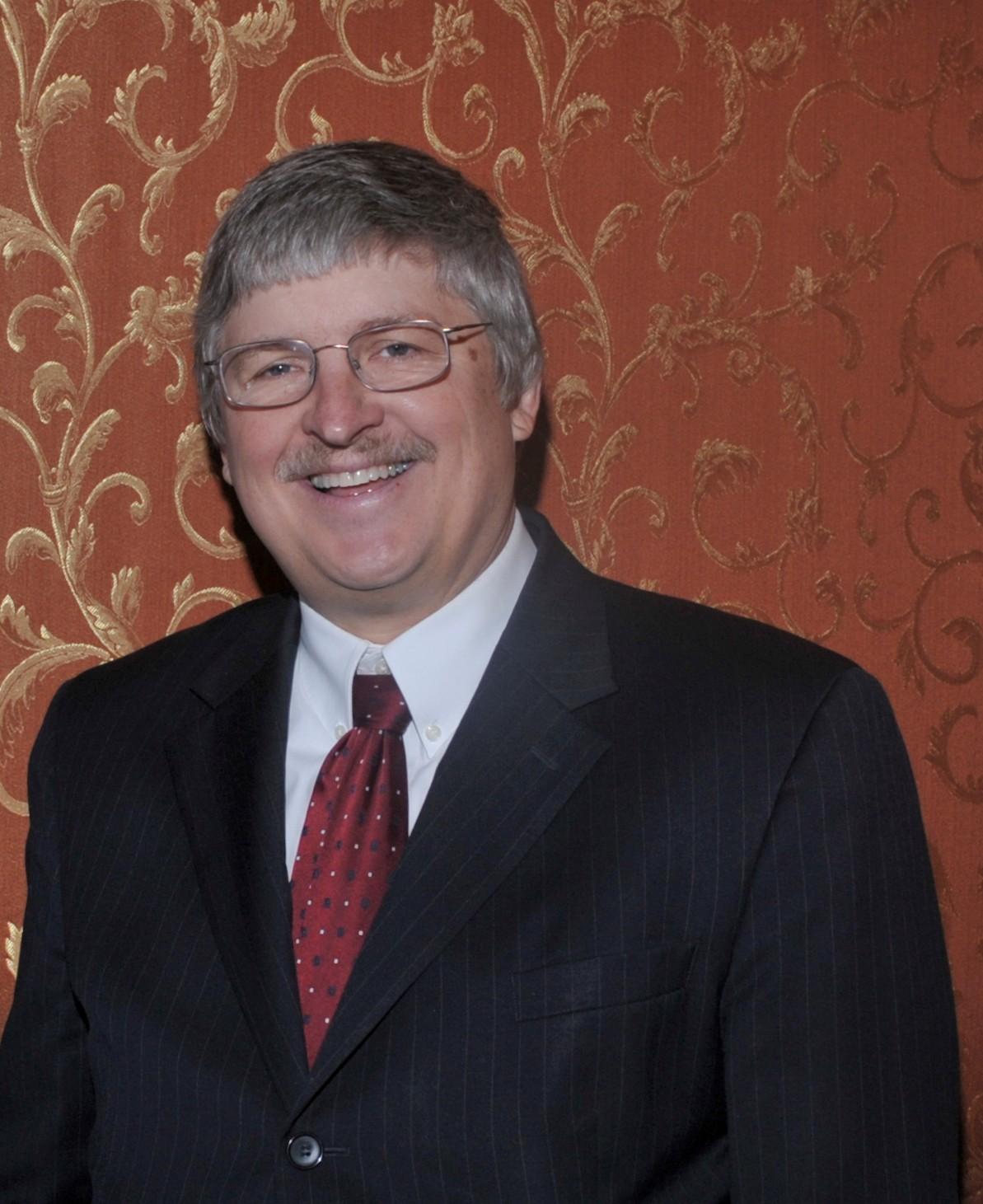 James McGuirk, Ph.D.,