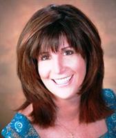 Michelle DeCarlo, Owner