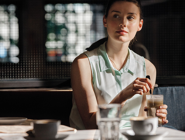 Woman Stirs Coffee Beverage