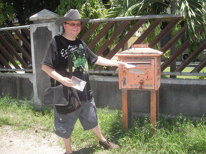 Andry mailing some postcards in East Timor