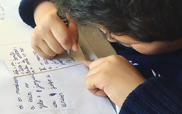 Child writing postcards