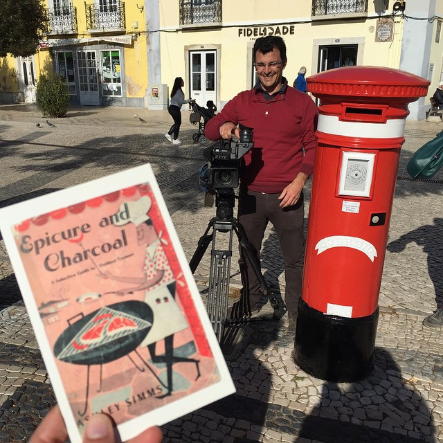 Mailing postcards in front of a camera
