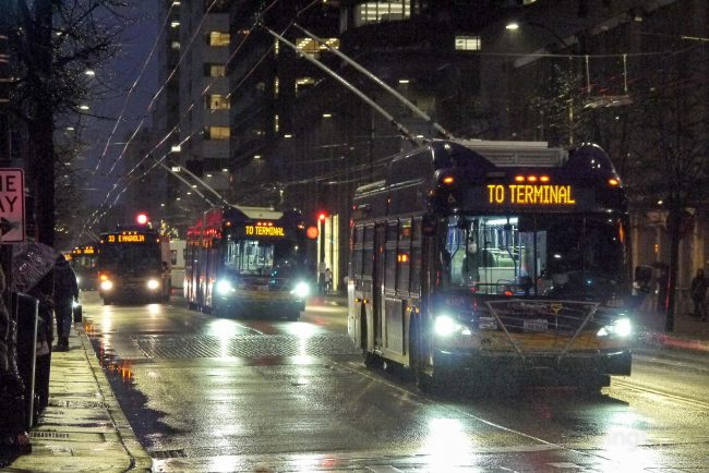 Rainy Third Avenue with lots of buses