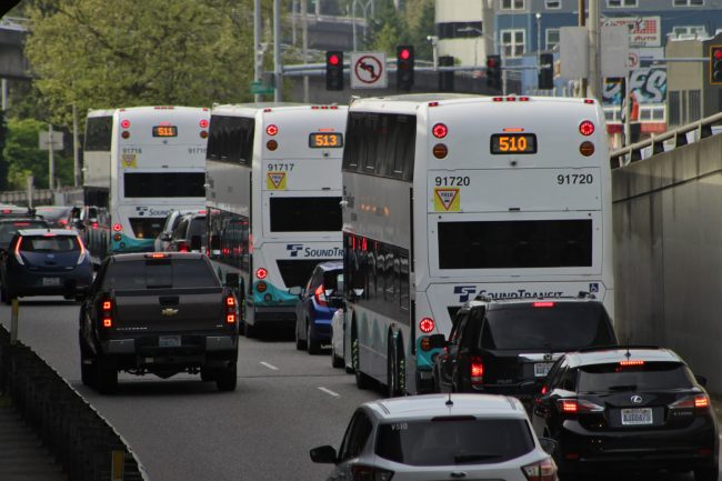 Cars and Double Tall buses on the Stewart Street offramp from the southbound I-5 regular lanes