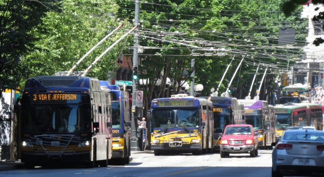 3rd Avenue, with many buses and a few cars