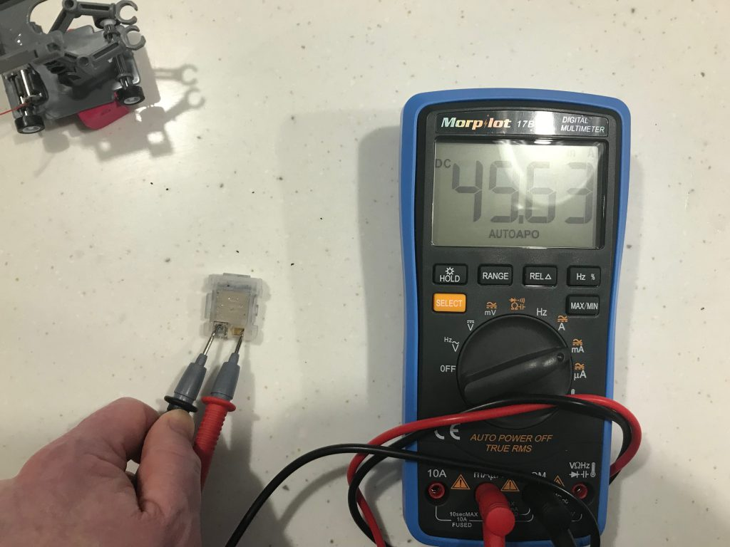battery and multimeter reading 49 milliamps