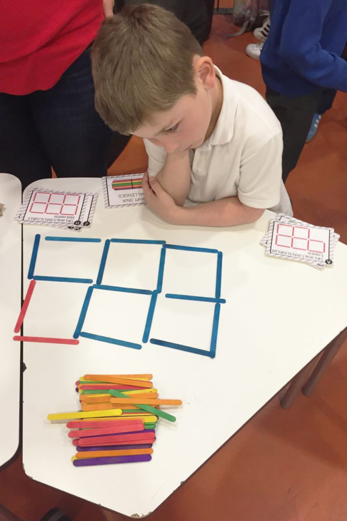 Boy doing maths puzzle