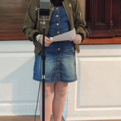 A preteen girl plays a part in the radio play
