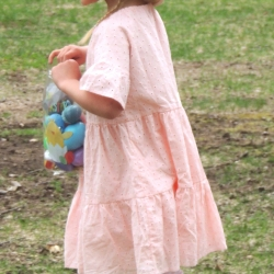 A girl hunts for easter eggs
