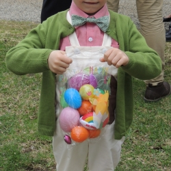 A boy shows off his Easter eggs