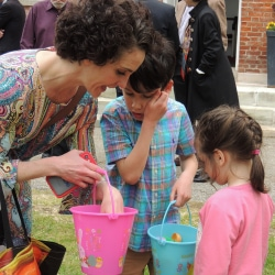A mother looks at the Easter Eggs her kids have found