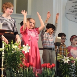 Children sing in the kids choir on Easter Sunday