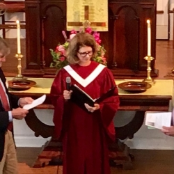 The church moderator and a retired pastor thank Brent for his service