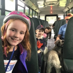 Children ride the bus back from the Construct Walk