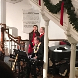 Pianist Joe Rose accompanies a duet between two young women