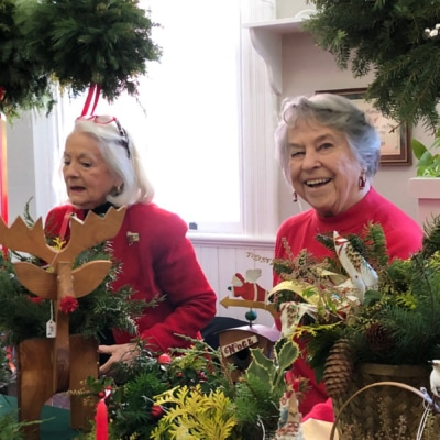 Women selling fresh Christmas greenery