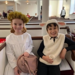A girl dressed as an angel and a boy dressed as a sheep.