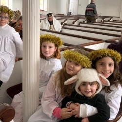 A group of children dressed as angels and sheep