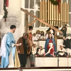 Angels, shepherds and sheep adore the baby Jesus