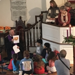 Children listen to the pastor's message featuring emojis