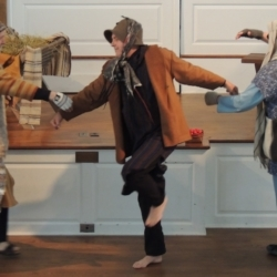 Three shepherds dance with one another