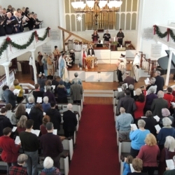 The congregation stands and sings The First Nowell