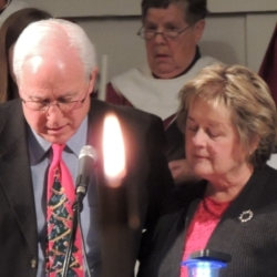 A middle-aged couple reads various texts from the Bible on the theme of light.
