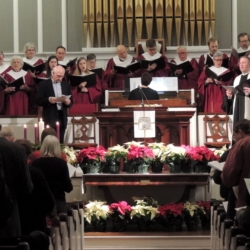 The choir sings a Christmas anthem
